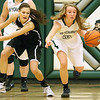 (Brad Davis/The Register-Herald) Wyoming East's Gabby Lupardus zips by PikeView's Madison May as she hustles up the court during the Lady Warriors' regional championship victory over the Panthers Friday night in New Richmond.