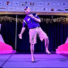 Contestant Vince Culicerto speaks briefly during the introduction portion of the Women's Resource Center's Hunks in Heels event Friday night at the Beckley-Raleigh County Convention Center.