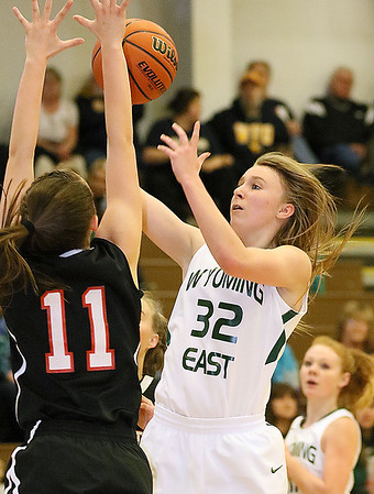(Brad Davis/The Register-Herald) Wyoming East's Gabby Lupardus drives to the basket as PikeView's Ashley Scott defends during the Lady Warriors' regional championship victory over the Panthers Friday night in New Richmond.