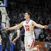 Poca's Luke Frampton (14) reacts after scoring against Wyoming East during their Class AA semi-finals state basketball tournament against Poca at the Charleston Civic Center in Charleston, W.Va., on Friday, March 18, 2016. Poca won 85-55. (Chris Jackson/The Register-Herald)