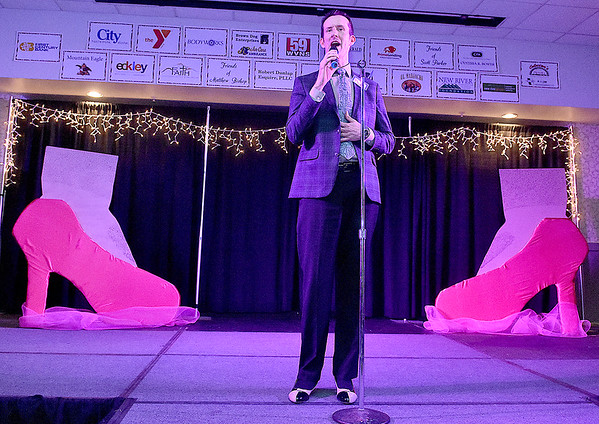 Contestant Jason Lowe speaks briefly during the introduction portion of the Women's Resource Center's Hunks in Heels event Friday night at the Beckley-Raleigh County Convention Center.