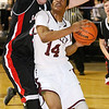 (Brad Davis/The Register-Herald) Woodrow Wilson's Malyk Fowlkes drives and scores as Oak Hill's Colby Gray defends during the Flying Eagles' win over the Red Devils Wednesday night at the Beckley-Raleigh County Convention Center.