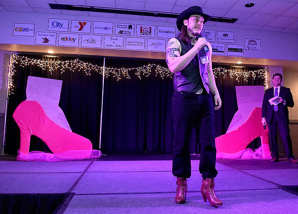 Contestant Cody Wickline speaks briefly during the introduction portion of the Women's Resource Center's Hunks in Heels event Friday night at the Beckley-Raleigh County Convention Center.