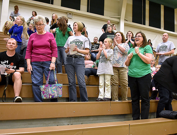 "(Brad Davis/The Register-Herald) Wyoming East fans and family chant ""Lady Warriors"" at the conclusion of a ceremony celebrating the school's first ever girls basketball state championship Monday evening in the school's gymnasium."