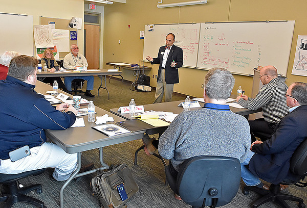 Tarek Moneir (standing), visiting speaker and Deputy Director of Development Services for the County of Roanoke, Virginia, delivers a seminar to local and out-of-state Rotary International members during a Rotary Leadership Institute meeting Saturday morning at New River Career and Technical College.