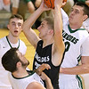 (Brad Davis/The Register-Herald) Westside's Broc Smith gets to the net through Wyoming East's Alec Lusk, left, and David Carte, right, during the Renegades' win over the Warriors Saturday night at the Beckley-Raleigh County Convention Center.
