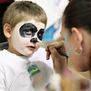Brendon Miller, 4, gets his face painted by Rising Stars Child Care's Melanie Slone during the Raleigh County Pre-K Expo at the Beckley-Raleigh County Convention Center on Wednesday. (Chris Jackson/The Register-Herald)