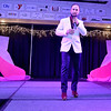 Contestant Ashton Nelson speaks briefly during the introduction portion of the Women's Resource Center's Hunks in Heels event Friday night at the Beckley-Raleigh County Convention Center.
