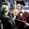 Brandon Gill, 18, a student at Woodrow Wilson and enrolled in ACT's Collision Repair Program shakes hands with educators after receiving his diploma during ACT's annual commencement Thursday, May 18, 2016, at The Beckley Raleigh County Convention Center in Beckley.(Chris Jackson/The Register-Herald)