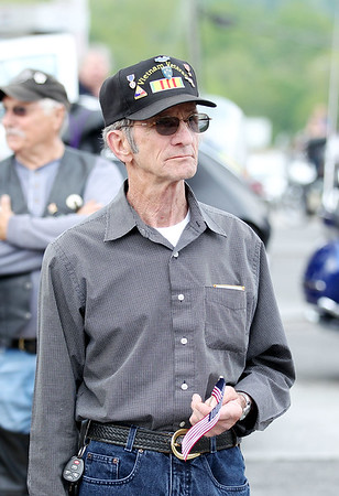 Hobert Salisbury, from Wallback, and served in Vietnam from 1967-68, watches Rolling Thunder as they roll through Rainelle during their annual Run for the Wall Thursday. Salisbury said he has always wanted to attend the event and talk with other veterans, but has always laid it off until Friday. (Chris Jackson/The Register-Herald)