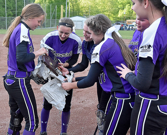 (Brad Davis/The Register-Herald) James Monroe players collectively unwrap their plaque following the Mavericks' regional championship win over Wyoming East Thursday evening in New Richmond.