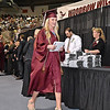 (Brad Davis/The Register-Herald) Woodrow Wilson graduate Katie Bolen receives her degree during the school's 90th Commencement Ceremony Saturday evening at the Beckley-Raleigh County Convention Center.