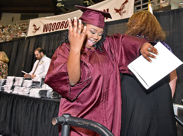 (Brad Davis/The Register-Herald) Woodrow Wilson graduate Zasheea' Baker breaks into dance as she exits the stage after receiving her degree during the school's 90th Commencement Ceremony Saturday evening at the Beckley-Raleigh County Convention Center.