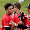 Oak Hill's Damario Davis after scoring a run during their Class AAARegion 3, Section 1 tournament game Monday in Oak Hill. Oak Hill won 9-3. (Chris Jackson/The Register-Herald)