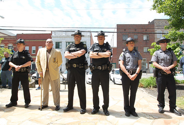 Law enforcement officers attend the annual police memorial at the Fayette County Courthouse in Fayetteville on Monday. (Chris Jackson/The Register-Herald)