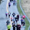 (Brad Davis/The Register-Herald) Participants make their way around during a 5K Glow Walk/Run to raise awareness for juvenile diabetes Friday night at the YMCA Paul Cline Memorial Sports Complex.