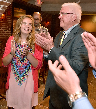 (Brad Davis/The Register-Herald) Beckley Mayor-elect Rob Rappold, right, and his granddaughter Sarah White react as news of his win makes its way through his election headquarters in the old McBee's location Tuesday night in Beckley.