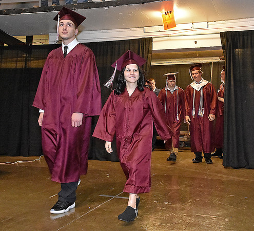 (Brad Davis/The Register-Herald) Woodrow Wilson graduates enter during the opening moments of the school's 90th Commencement Ceremony Saturday evening at the Beckley-Raleigh County Convention Center.