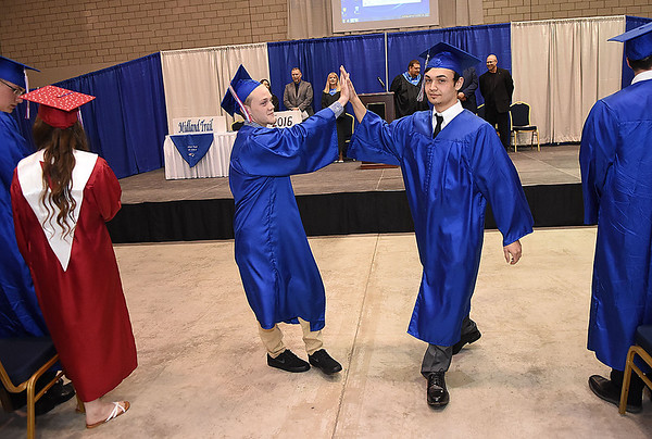 Brody Jackson, left, and Weston White, high five each other during the Midland Trail High School graduation held at the Summersville Arena & Conference Center.<br /> (Rick Barbero/The Register-Herald)