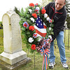 Ian Bone, of Buffalo, NY, he's a 5th generation grandson of Alfred Beckley, places a wreath in front of Alfred Beckley's grave in the Wildwood Cemetary during the 8th annual Founders Day celebration.<br /> (Rick Barbero/The Register-Herald)
