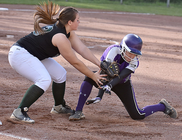 (Brad Davis/The Register-Herald) Wyoming East first baseman Kaithlyn Mills, left, tags out James Monroe's Audra Winebrimmer after she was picked off and caught in a rundown during the Lady Warriors' loss to James Monroe Thursday evening in New Richmond.