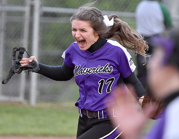 (Brad Davis/The Register-Herald) James Monroe starting pitcher Alexis Carter reacts after the last out is made in the Mavericks' regional championship win over Wyoming East Thursday evening in New Richmond.
