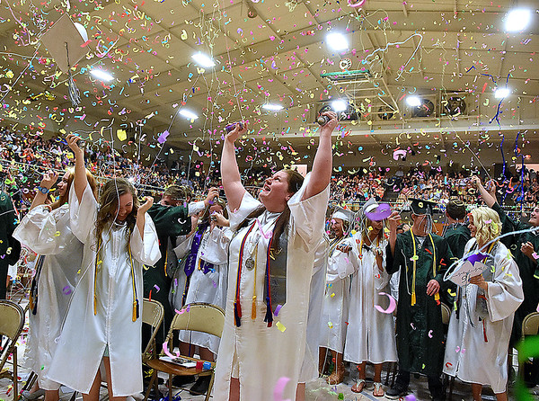 (Brad Davis/The Register-Herald) Graduating seniors from Fayetteville High School burst into a silly string-laden celebration at the conclusion of the school's 2016 Commencement ceremony Friday night at the Soldiers and Sailors Memorial.