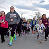 (Brad Davis/The Register-Herald) Maggie Little (3rd from left, neon socks), 16, and her friend Caitlyn Daniels (3rd from right, maroon top), 15, join over 65 other runners and walkers as they take off from the starting line during a 5K Glow Walk/Run to raise awareness for juvenile diabetes Friday night at the YMCA Paul Cline Memorial Sports Complex. The Woodrow Wilson sophomores both have type 1 diabetes and organized the event to both shed light on the issue and to raise money for the Juvenile Diabetes Research Foundation.