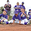 (Brad Davis/The Register-Herald) Torches player Elijah Petrey (middle) makes a pile as he and his young teammates pass the time by playing in the infield dirt while hundreds of other players, coaches and families line up on the Beckley Little League field during an opening day ceremony for the teeball league Saturday afternoon. Pictured with Petrey are teammates (left to right), Blake Pugalee, Logan Crouse, Kaleb Stewart and Aliyah Fleming.