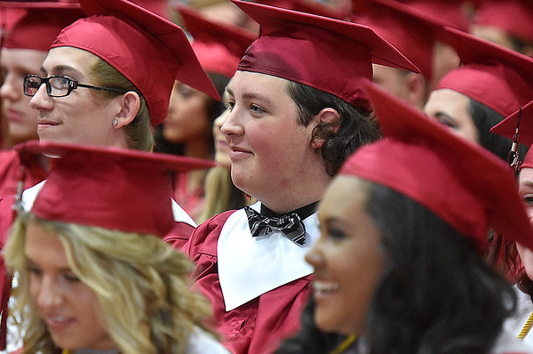 (Brad Davis/The Register-Herald) Graduating seniors from Oak Hill High School wait to receive their degrees during the school's 2016 Commencement ceremony Friday night inside the school's gymnasium.
