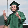 (Brad Davis/The Register-Herald) Graduatiing Greenbrier East senior Cole Booze gestures to the crowd as walks on stage to collect his diploma during the school's 48th annual commencement ceremony Saturday night at the State Fairgrounds in Fairlea.