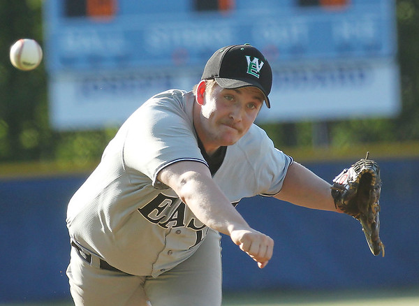 Wyoming East's pitcher (12) delivers a pitch during their game against Independence in Coal City on Tuesday. (Chris Jackson/The Register-Herald)