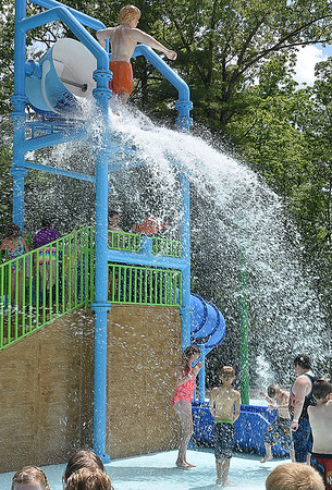 (Brad Davis/The Register-Herald) A giant bucket of water pours onto park-goers every few minutes inside the new Splash Park at Lake Stephens Saturday afternoon.