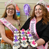 (Brad Davis/The Register-Herald) Ms. Rhododendron Festival Amanda Sloan, right, and Teen Miss Rhododendron Riley Bowyer try to entice with cupcakes as they pose for a quick photo during Sweat Treats May 14 in Beckley.