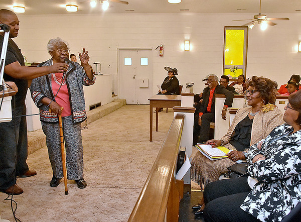"(Brad Davis/The Register-Herald) Former music teacher Eunice B. Fleming (speaking at left), generates a number of smiles and laughs as she gives a few words of thanks and reflects on her teaching years after being named one of six honorees during Second Baptist Church's ""A Night of Music,"" honoring those who've made significant contributions to musical education throughout the area Saturday night at the ""F"" Street church. Holding the mic for her is Xavier Oglesby (far left), one of her students when he was all-county chorus in 1985. Now 93, Fleming began her teaching career at the all black DuBois School in Mt. Hope as the faculty's youngest member in 1944 and continued there through its integration for many decades. In 1957 she became the first black person to give a master's recital at Marshall University and in 1973 became the first black person to sing at the school's commencement ceremony. After severeal decades of teaching and service at various churches, she retired as the community choir director of the New River Associates of the West Virginia Baptist Church at the age of 90. The five other honorees were former mayor Emmett Pugh, Betty Hughes, Rayfus Parham, Denise Seay and Helen Dobson."