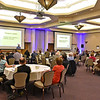 "(Brad Davis/The Register-Herald) Teams of attendees listen as speaker Sutton Stokes, Associate Director of the West Virginia Center for Civic Life, begins the discussion of health in the region, one of seven ""threads,"" or topics, during the Rise Up Southern West Virginia Conference Wednesday afternoon in the Tamarack Ballrooms."