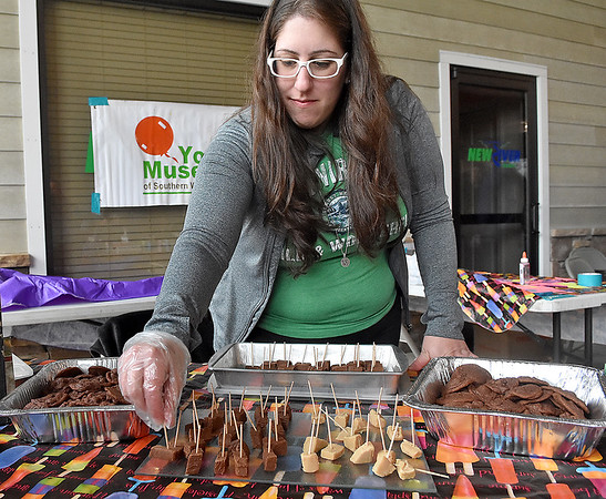 (Brad Davis/The Register-Herald) Youth Museum's Jeni Duvins keeps her trays sticked with homemmade fudge during Sweat Treats May 14 in Beckley.
