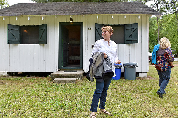 (Brad Davis/The Register-Herald) Ashe County, North Carolina residents Linda Slade, left, and Laura Green, tour the grounds at the historic and newly revitalized Camp Brookside during a special opening event Saturday afternoon in Brooks near Hinton. Every building, most significantly the cabins like the one seen in the background was completely refurbished, giving the island camp ground a brand new feel.