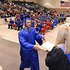 Andrew Dickerson, left, receives his diploma from Diana Blume, principal, during the Midland Trail High School graduation held at the Summersville Arena & Conference Center.<br /> (Rick Barbero/The Register-Herald)