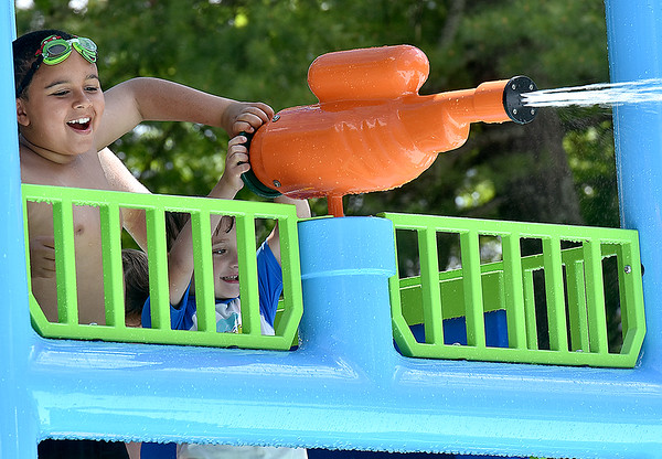 (Brad Davis/The Register-Herald) Mischievous youngsters shoot water from a canon atop a tower inside the Splash Park at Lake Stephens Saturday afternoon.
