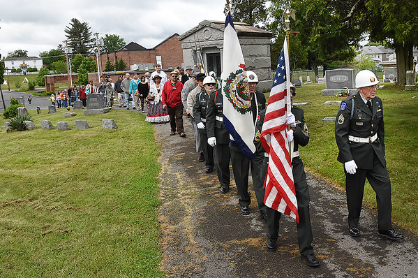 American Legion Post 32 lead a procession from the Wildwood Museum to Alfred Beckley's gravesite in the Wildwood Cemetary during the 8th annual Founders Day celebration.<br /> (Rick Barbero/The Register-Herald)