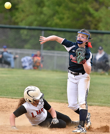 (Brad Davis/The Register-Herald) Independence shortstop Nicole Kester throws to first after forcing out Liberty's Ashton Mullens for the first out of a double play during the Patriots sectional championship win over the Raiders Saturday afternoon in Coal City.
