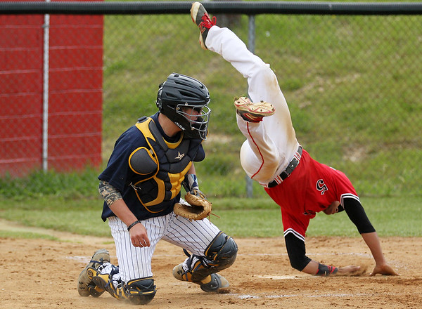 Oak Hill's Samaria Davis leaps over Shady Spring's catcher Noah Farley after colliding without the ball for the first run of the night during their Class AAARegion 3, Section 1 tournament game Monday in Oak Hill. Oak Hill won 9-3. (Chris Jackson/The Register-Herald)