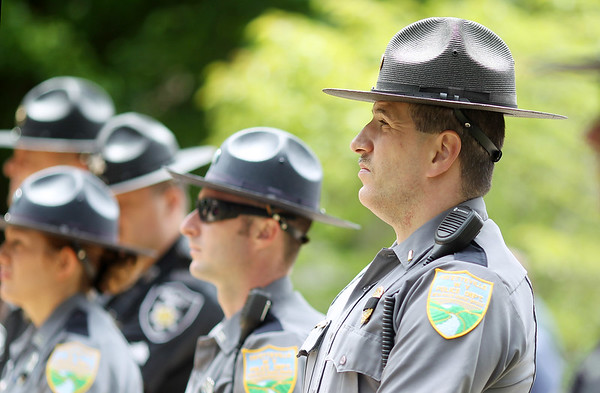 Fayetteville police Lt. D.L. Keizer watches along with other members of the police force as well as neighboring cities, counties and state police officer during the annual police memorial at the Fayette County Courthouse in Fayetteville on Monday. (Chris Jackson/The Register-Herald)