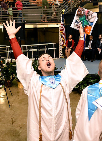 Josh Cook celebrating after the Liberty High School graduation ceremony held at the Beckley-Raleigh County Convention Center Saturday afternoon.<br /> (Rick Barbero/The Register-Herald)