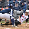 (Brad Davis/The Register-Herald) Liberty's Makiya Caron is tagged out at home plate by Independence catcher Katy Lilly after a strong throw from centerfielder Jordan Hall during the Patriots' sectional championship win over the Raiders Saturday afternoon.
