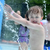 (Brad Davis/The Register-Herald) Three-year-old Benson Helton plays in a sprinkler at the new splash park Saturday afternoon at Lake Stephens.