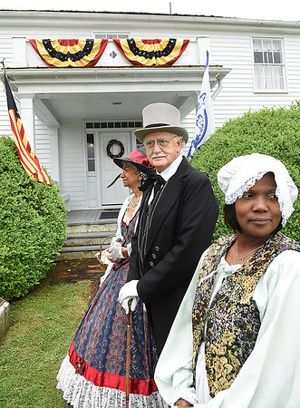 Edwina Ziegler, protraying Jane Beckley, Alfred Beckley's second wife, left, Gerald Godfrey, as Alfred Beckley and Shawnette Allen, as Jenny, Alfred Beckley's servant, stand in front of the Wildwood House Museum during the 8th annual Founders Day celebration.<br /> (Rick Barbero/The Register-Herald)