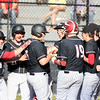 Greater Beckley Christian's (16) is met by his teammates after hitting a grand slam during their game against Fayetteville in Beckley on Tuesday. (Chris Jackson/The Register-Herald)