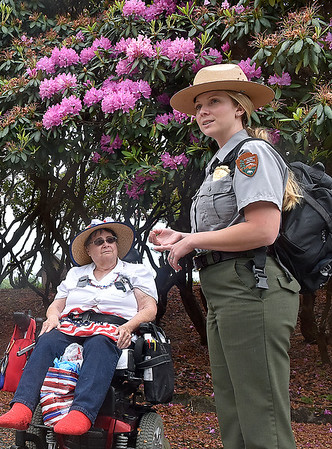 (Brad Davis/The Register-Herald) National Park Service guide Abby Adkins, right, provides some brief information on Grandview Park's array of Rhododendron bushes as she leads a group Sunday, while participant Beth Stanley, left, looks on yesterday afternoon.